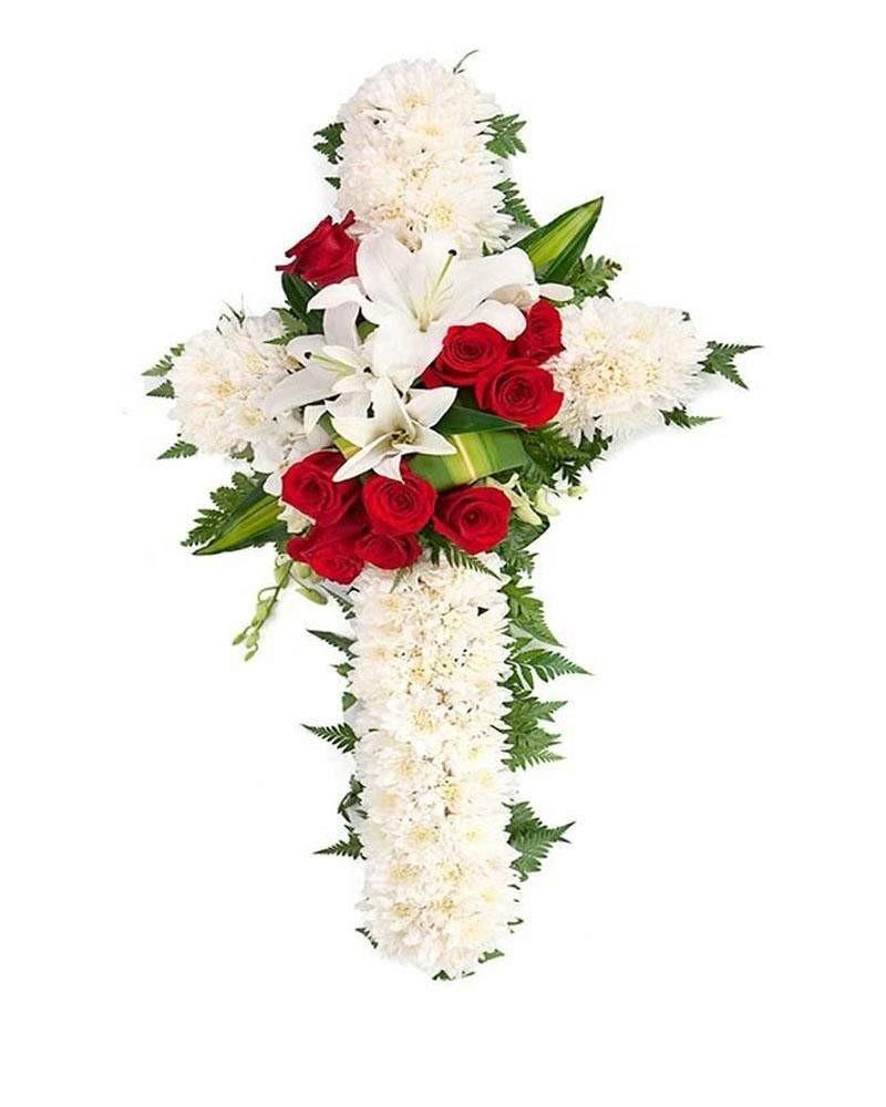 Cruz de flores fúnebres.